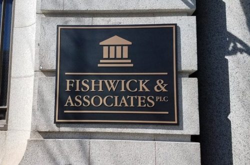 brushed cast bronze plaque mounted outside bank building