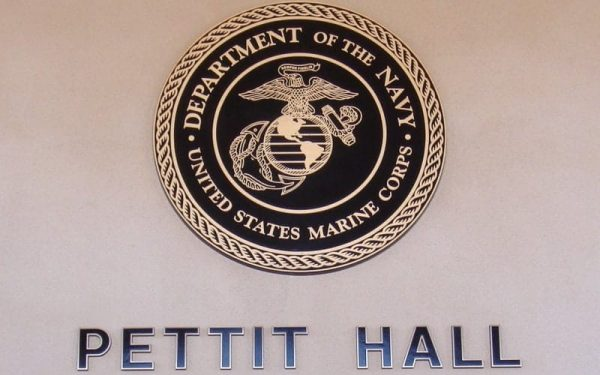 large cast bronze marine corps seal plaque mounted outside military base building