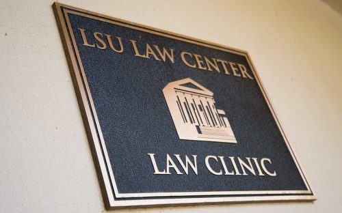 brushed cast bronze plaque for law clinic outside wall