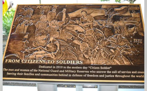 cast bronze plaque in brushed finish with photo sculpted portrait for military soldier memorial and dedication