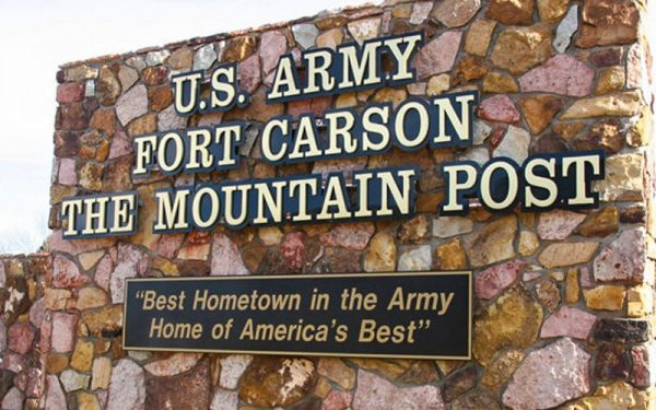 solid cut brushed bronze letters on black acrylic backer for army fort carson monument