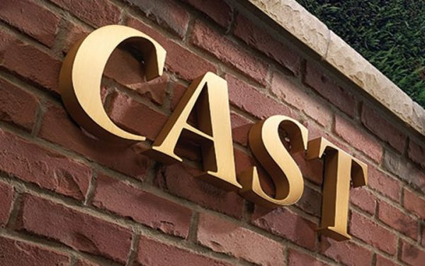 thick brushed cast bronze letters mounted on brick