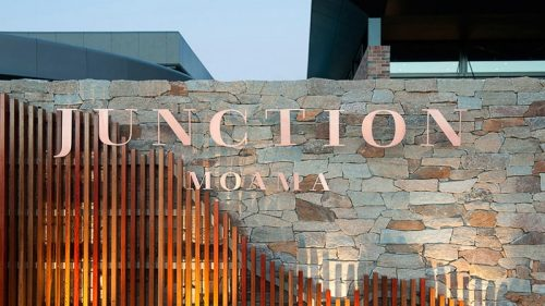 brushed flat cut copper metal letters outside hotel