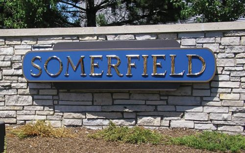 polished cast bronze letters in prismatic beveled face font style outside neighborhood