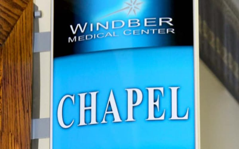 projected curved wall sign with removable face for church