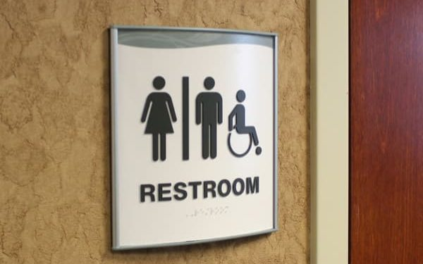 curved wall sign for restroom with ada braille