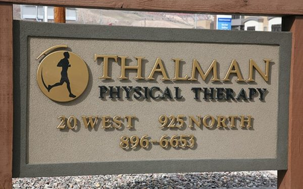gold and navy formed plastic letters and custom logo outside physical therapy doctors office