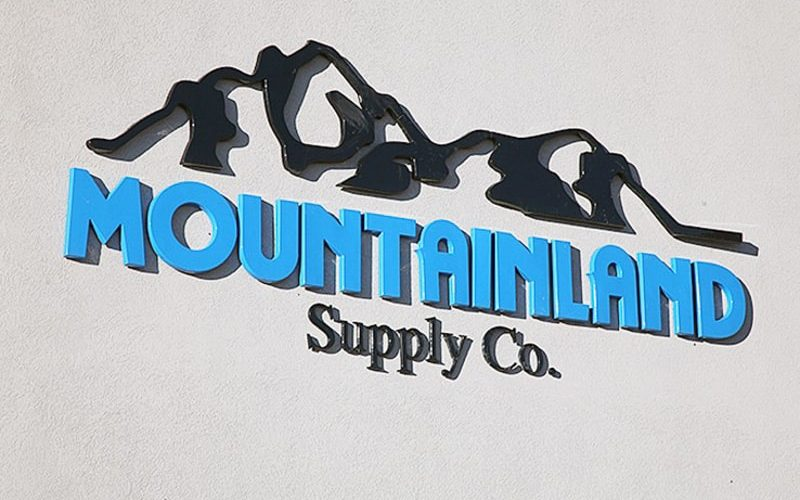 blue and black custom formed plastic logo and letters outside business store front