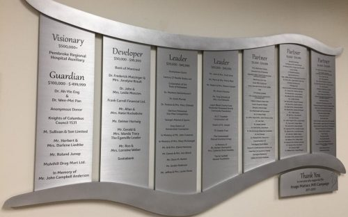 brushed etched stainless steel plaques with black text for commemorative donor wall