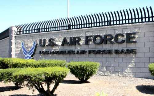 thick fabrictated aluminum letters and logo in painted matte black for air force military base entrance