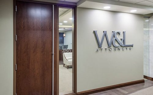 thick fabricated aluminum letters in brushed finish for interior lobby of attorney office