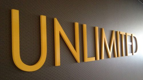 painted yellow gatorfoam letters on office lobby wall