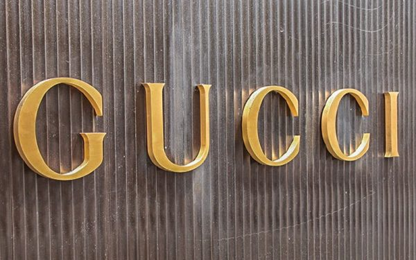 Gold Anodized Aluminum Letters mounted on corrugated siding for gucci retail store