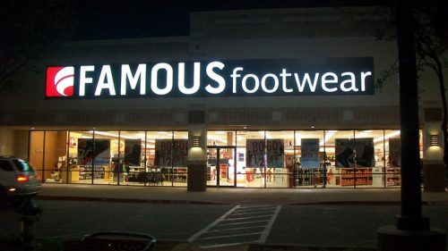 front lit channel letters and logo in white and red for famous footwear outside storefront