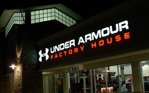 front lit channel letters in white and red for under armour retail storefront