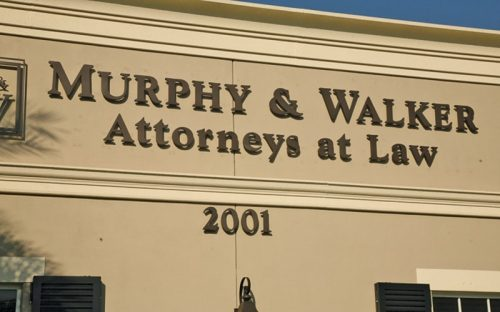 painted acrylic letters in duranodic bronze color mounted outside attorneys office