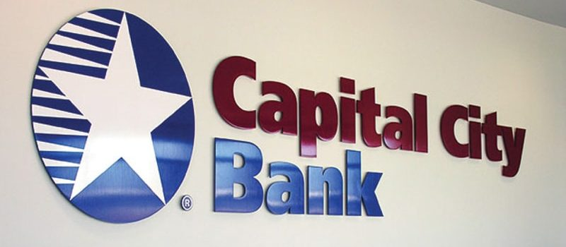 painted solid cut aluminum letters with white vinyl logo for bank lobby wall