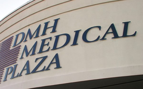 painted solid cut aluminum letters in black and maroon logo outside medical building