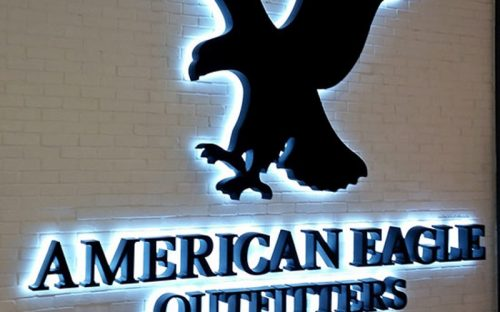 halo lit painted black sign for american eagle with white LEDs back lighting inside mall