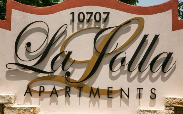 painted solid cut aluminum letters in black and gold for la jolla apartments complex entrance monument