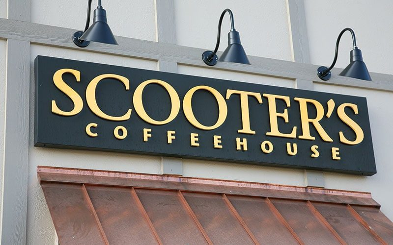 painted brilliant gold acrylic letters mounted on black metal panel for scooters coffee