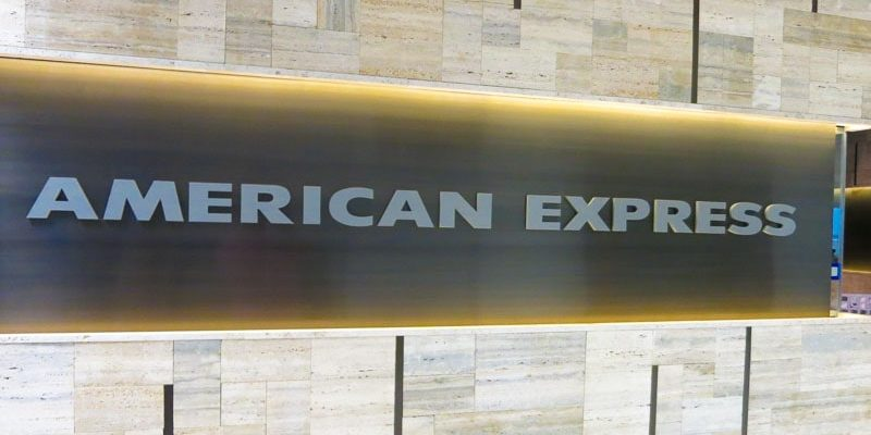 painted metallic silver acrylic letters mounted flush on panel american express lounge wall