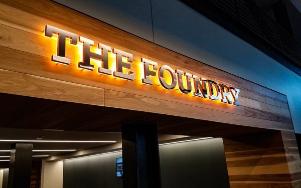 polished stainless steel backlit letters with warm white leds mounted inside restaurant