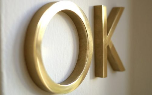 solid brass letters in polished mirror finish closeup flush mounted
