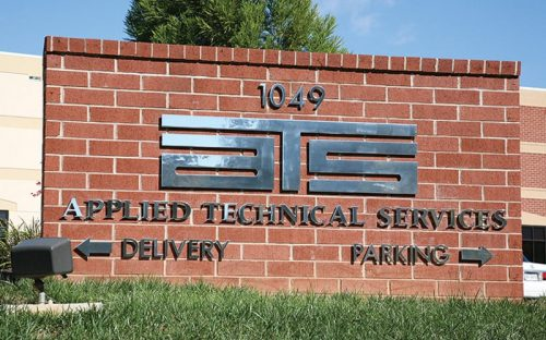mirror polished solid cut stainless steel letters and logo mounted outside on brick monument