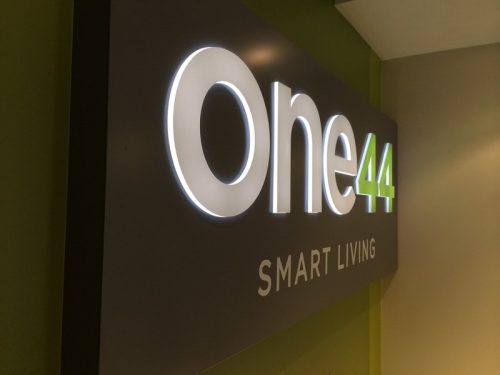 Push Through Acrylic Illuminated Sign in painted with Vinyl Graphics for inside lobby wall